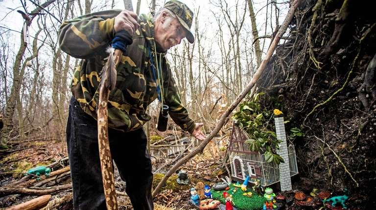 Andy Kuzma, of Levittown, shows the gnome house