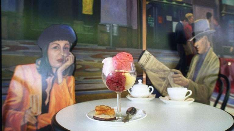 A glass of gelato on a table inside