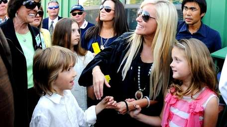 Phil Mickelson's wife Amy, his son Evan, daughter