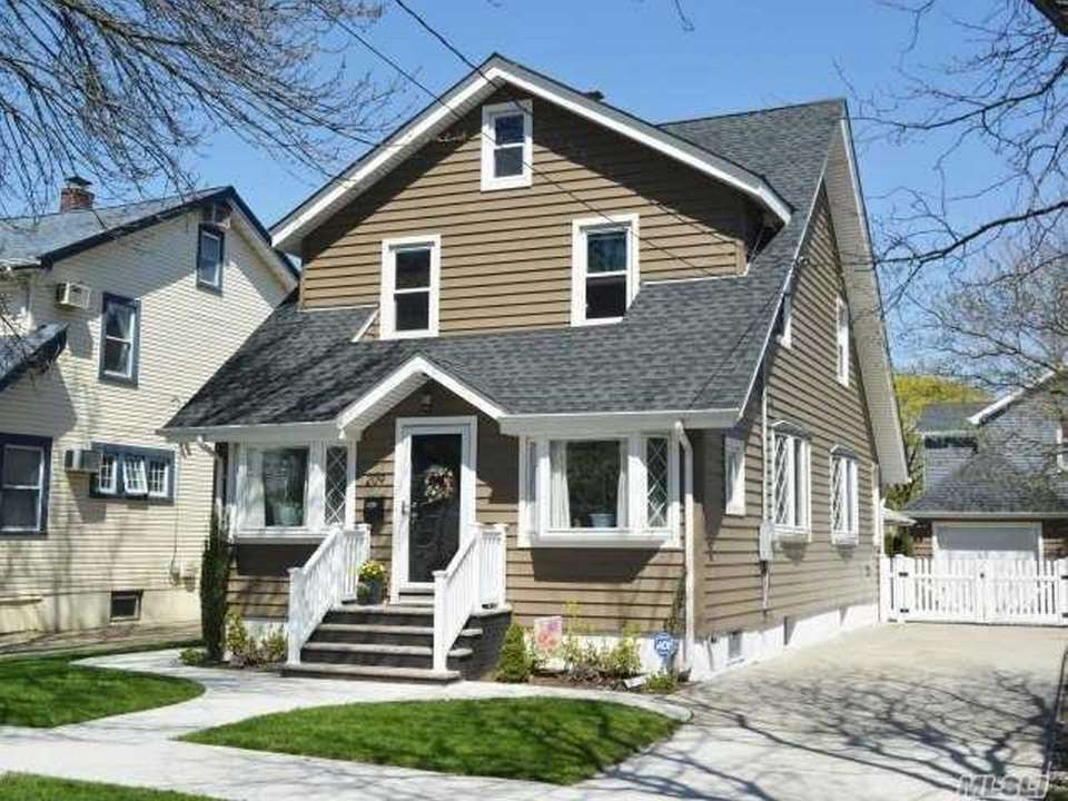 This Floral Park Colonial includes three bedrooms and