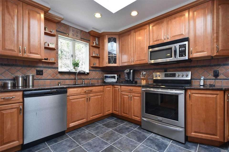 The kitchen in this Medford ranch features granite