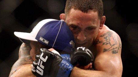 Frankie Edgar celebrates beating BJ Penn for the
