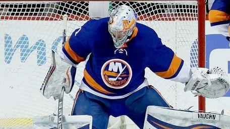 Islanders goaltender Thomas Greiss swipes the puck aside