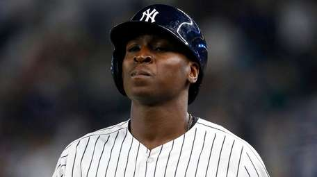 Didi Gregorius of the Yankees looks on after