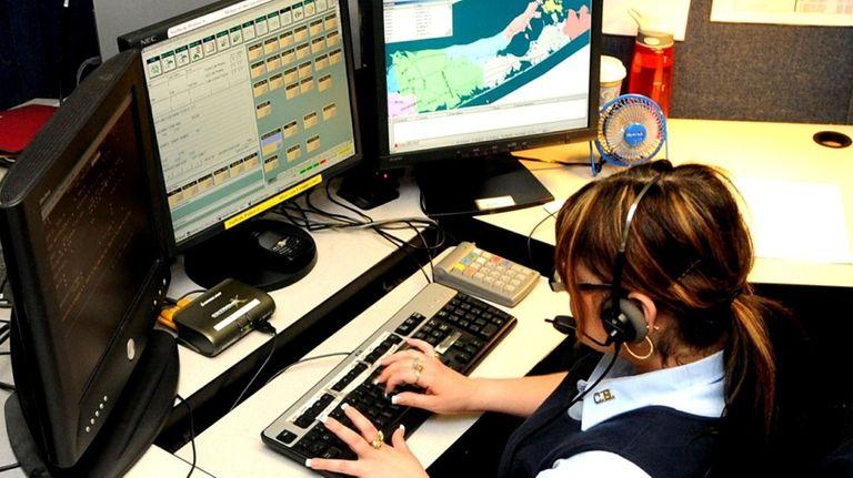 Emergency 911 operator Mindy Zoota, 40, fields calls
