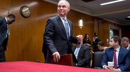 Environmental Protection Agency Administrator Scott Pruitt, accompanied by