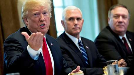 U.S. President Donald Trump speaks as U.S. Vice