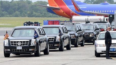 A motorcade awaits President Donald Trump's arrival at
