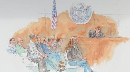 U.S. District Judge Joan Azrack addresses jurors during