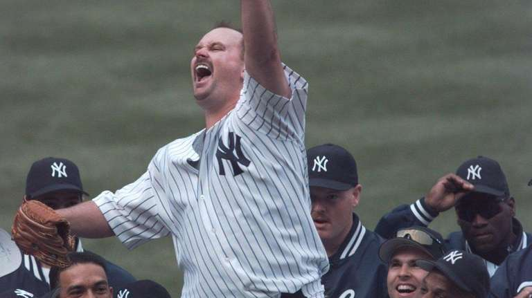 David Wells waves to the crowd as he