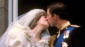 Princess Diana and Prince Charles share a kiss