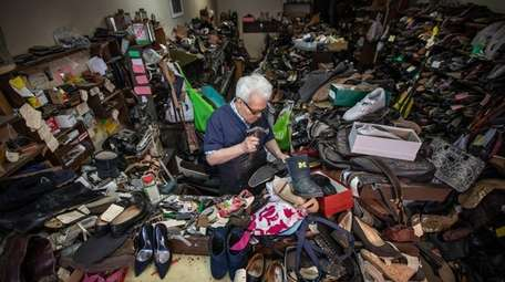 Surrounded by orders, Andrea Sorrentino helps customers put