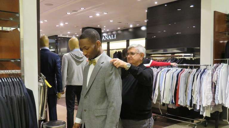Marcus Heyward gets fitted for a new suit,
