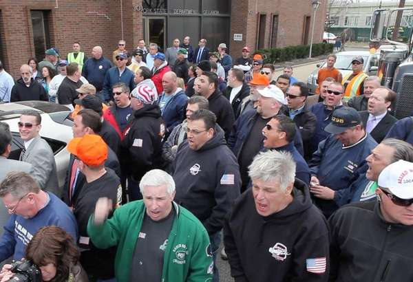 Construction workers last month held a mock funeral