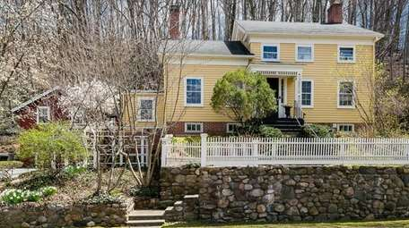 This Roslyn Village home features a detached structure