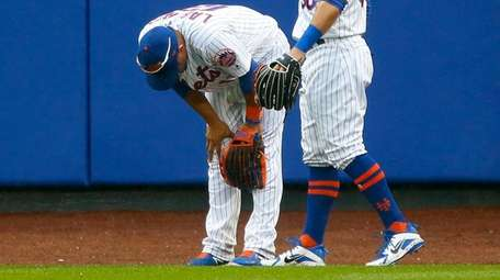 Juan Lagares after colliding with the wall on