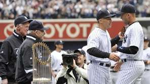 Yankees Whitey Ford and Yogi Berra watch Derek