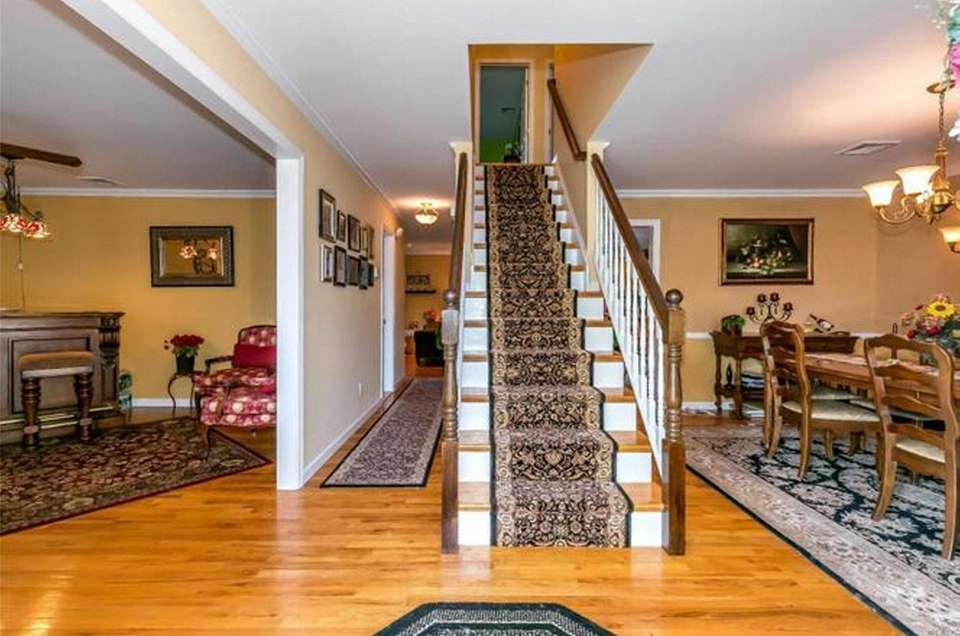 The entry foyer in this Bethpage Colonial is