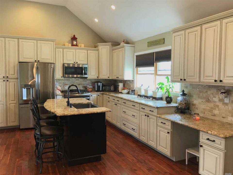 The updated eat-in kitchen in this Farmingdale ranch
