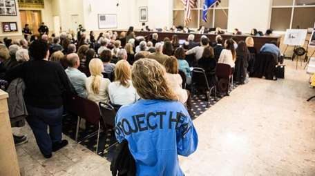 Residents and others attend a Feb. 7 public