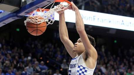 Kentucky's Kevin Knox dunks during the second half