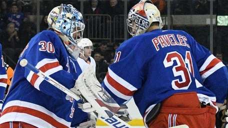 Rangers goaltender Henrik Lundqvist skates in to replace