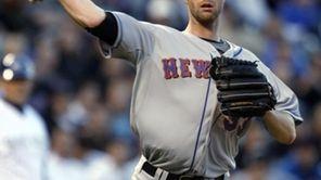 New York Mets starting pitcher John Maine turns