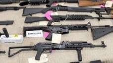 Weapons on display during a news conference at