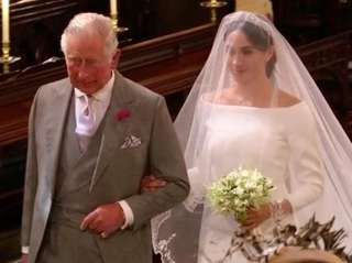 Meghan Markle walks down the aisle with Prince