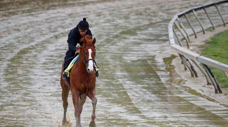 Kentucky Derby winner Justify, with exercise rider Humberto
