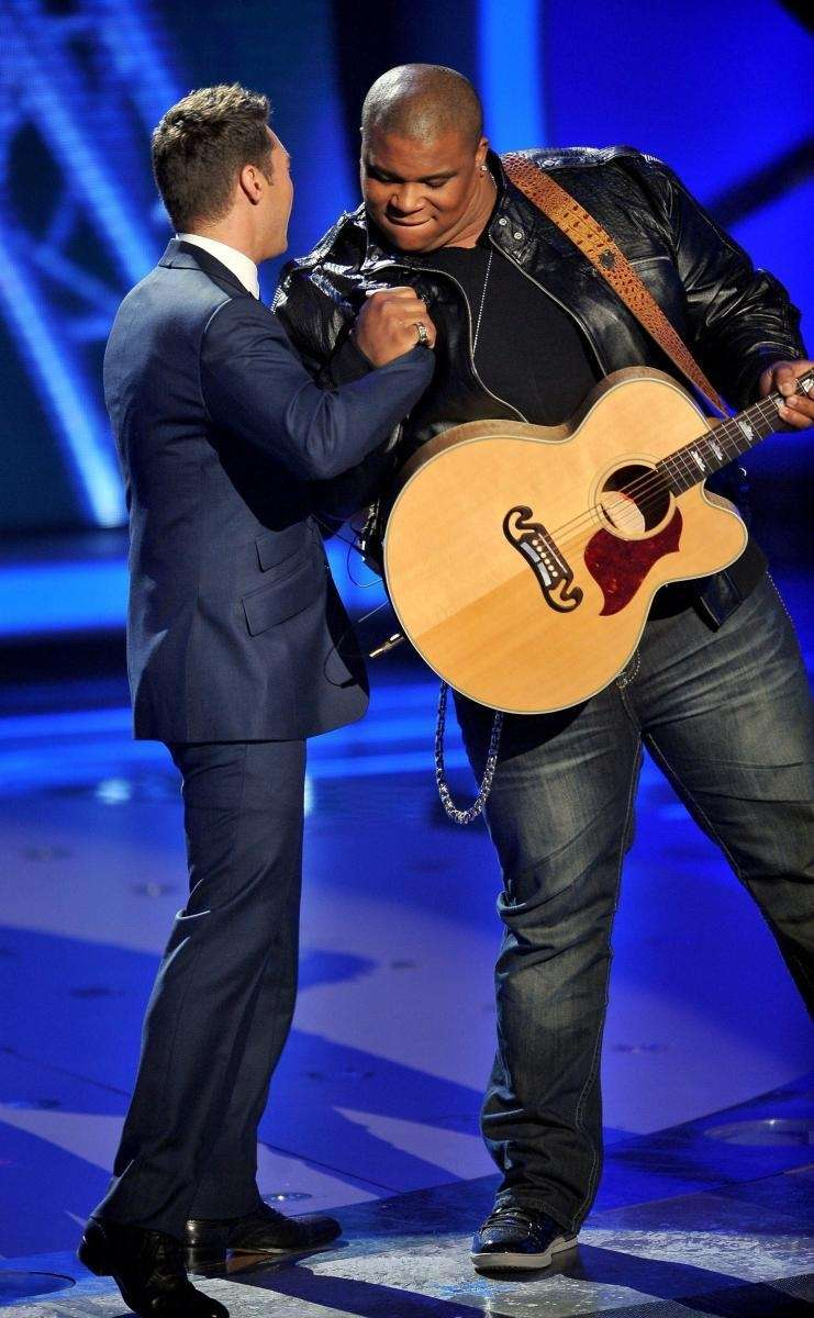 Host Ryan Seacrest, left, and contestant Michael Lynche