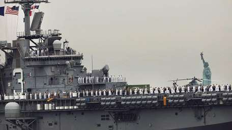 The USS Kearsarge makes its way past the