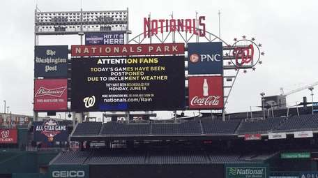 The tarp covers the field at Nationals Park