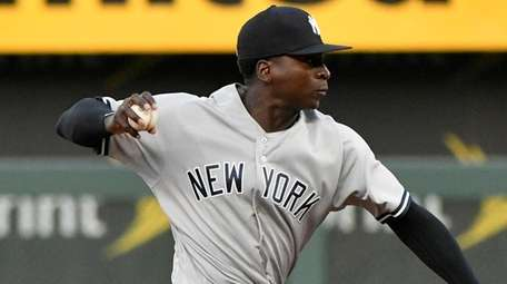 Didi Gregorius throws to first to get the