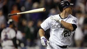 Colorado Rockies' Chris Iannetta tosses his bat as