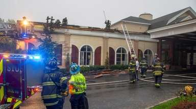 Firefighters at the North Ritz Club in Syosset,