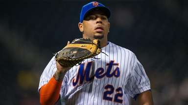 The Mets' Dominic Smith looks on against the