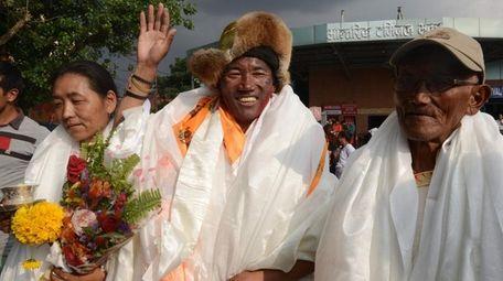 Nepali sherpa Kami Rita, 48, arrives triumphantly Sunday