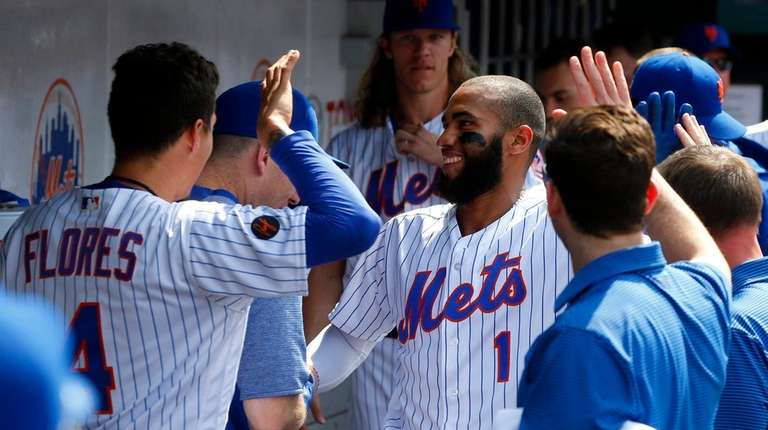 Amed Rosario celebrates his seventh-inning home run