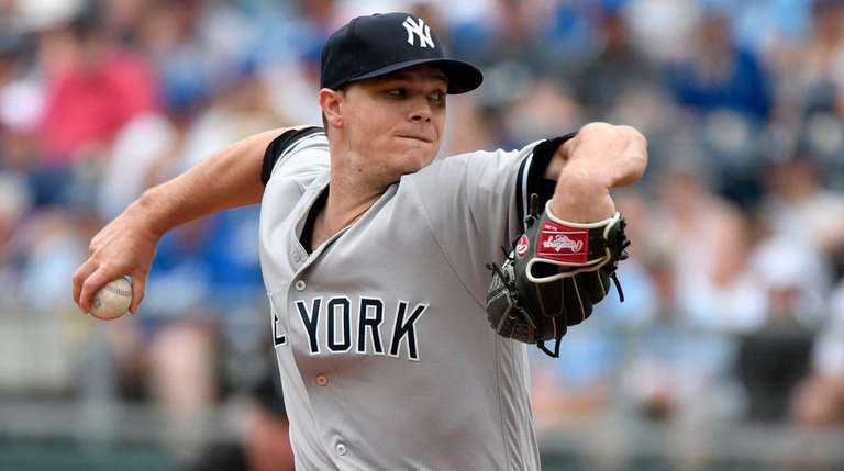 The Yankees' Sonny Gray pitches in the first