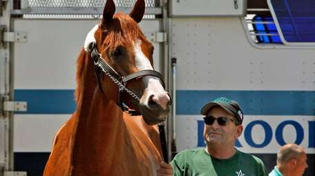 Assistant trainer Jimmy Barnes holds Preakness Stakes and