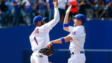 Amed Rosario #1 and Brandon Nimmo #9 of