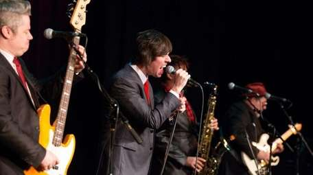 Blues Beatles perform Beatles songs in a blues