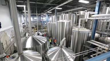 Blue Point Brewing Co. employees make preparations to