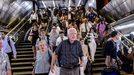 Passengers rush to catch LIRR trains in Penn
