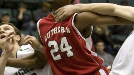 Long Island Lutheran's Achraf Yacoubou (24) is Newsday's