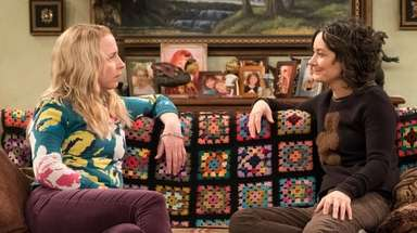 "Lecy Goranson and Sara Gilbert in ""Roseanne."""
