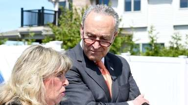Sen. Chuck Schumer with Rhonda Verrier in front