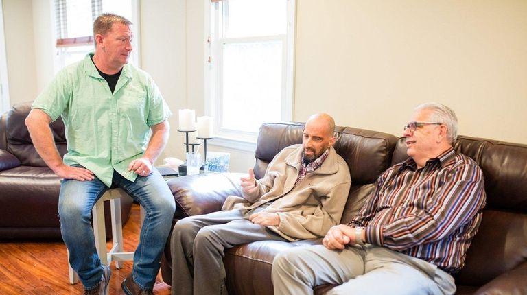 Scott Blackshaw, center, with friend Wayne Forte, left,