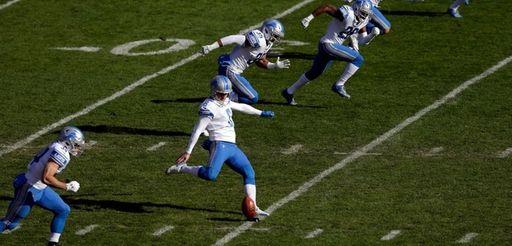 Detroit's Sam Martin kicks off during the first